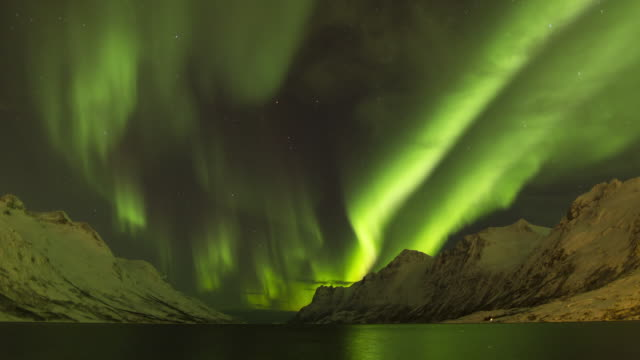 aurora borealis, northern lights, troms region, norway - pole stock videos & royalty-free footage