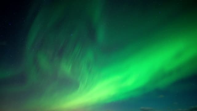 aurora borealis, northern lights with stars in the night sky on arctic circle at north pole - magnet stock videos & royalty-free footage