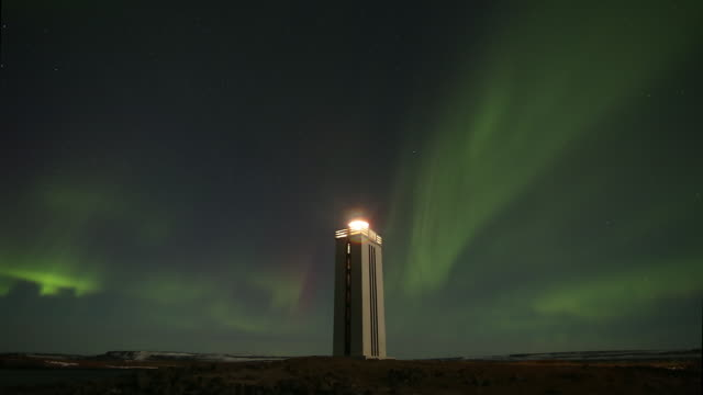 Aurora Borealis over Kálfshamarsvík Lighthouse.