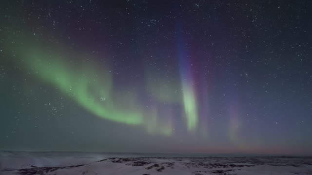 T/L of aurora from top of hill in Arctic