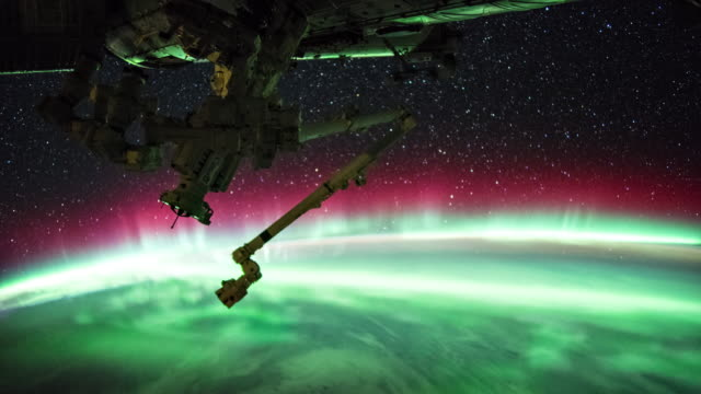 aurora over the earth seen from iss - digital composite stock videos & royalty-free footage