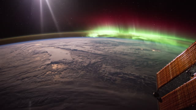 aurora over the earth seen from iss - stratosphere stock videos & royalty-free footage