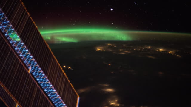 aurora over the earth seen from iss - alternative energy stock videos and b-roll footage
