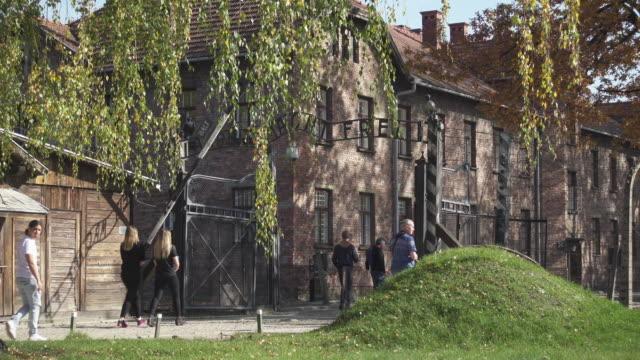 auschwitz holocaust concentration camp, auschwitz-birkenau, krakow, poland - western script stock videos & royalty-free footage