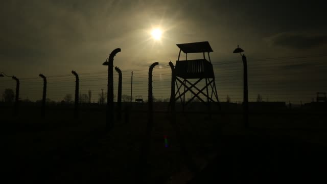 auschwitz ii birkenau extermination camp on november 15 2014 in oswiecim poland ceremonies marking the 70th anniversary of the liberation of the camp... - campo di concentramento video stock e b–roll