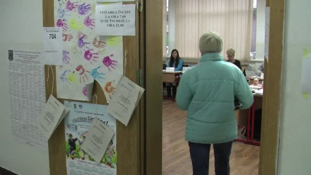 austerity weary romanians voted for a new parliament sunday with the centre left ruling coalition on course for a large victory that was likely to... - trigger stock videos & royalty-free footage