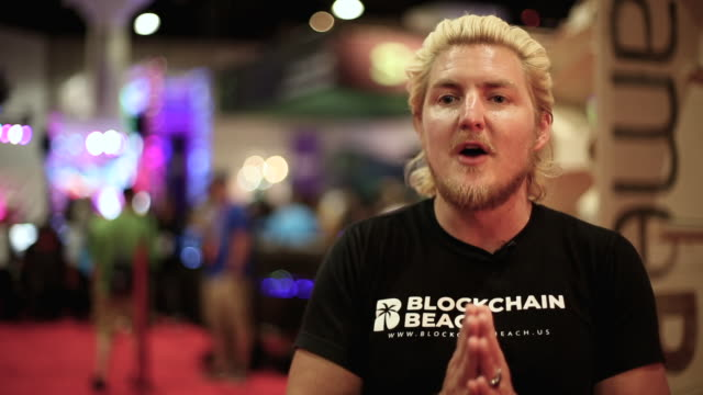 austin davis, ceo & co-founder of blockchain beach talks about his short term goal of expanding the blockchain beach brand and welcoming more people... - interview raw footage stock videos & royalty-free footage