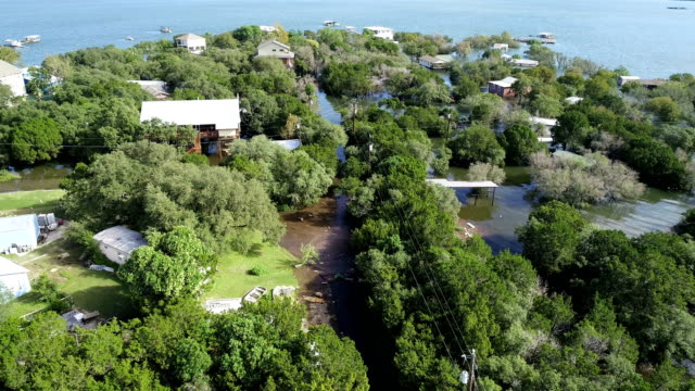 austin flooding at travis lake neighborhood graveyard point - pianificazione di emergenza video stock e b–roll