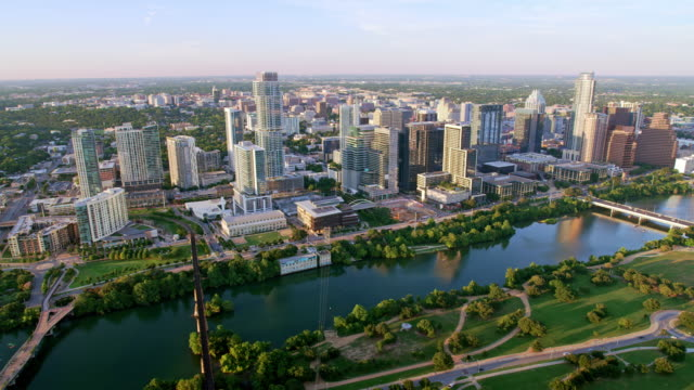 aerial austin from the auditorium shores along the colorado river, texas - austin texas stock videos & royalty-free footage