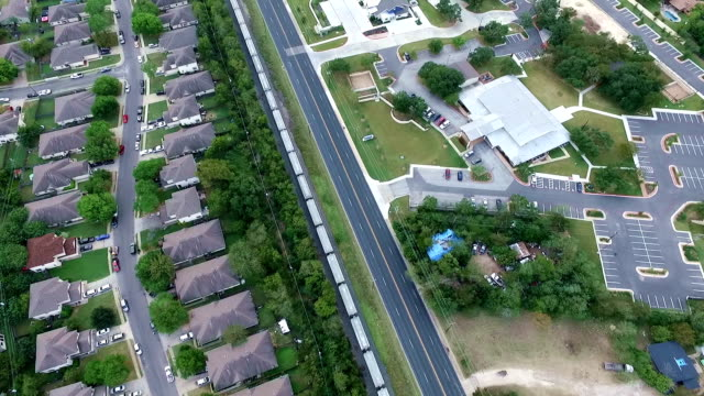 austin metro rail train transportation aerial above homes and houses in suburb new modern development in central texas outside of austin, tx - modern rock stock videos & royalty-free footage