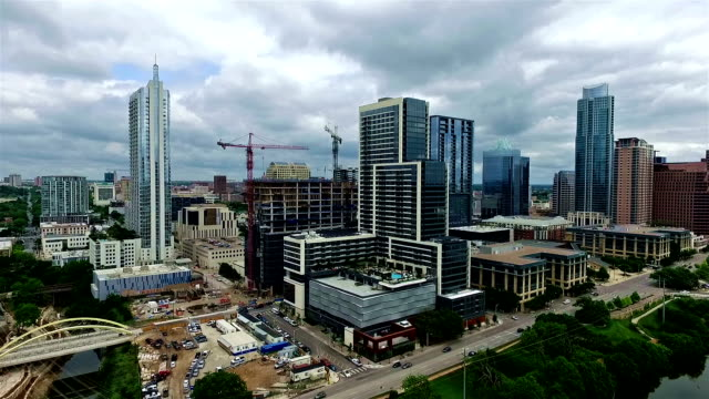 austin new construction of jenga tower and the new northshore building - crane stock videos and b-roll footage
