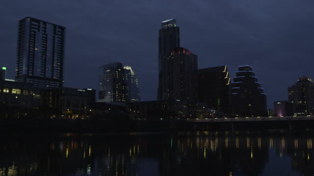 LA MS of Austin skyline and Colorado River at dusk with rack focus