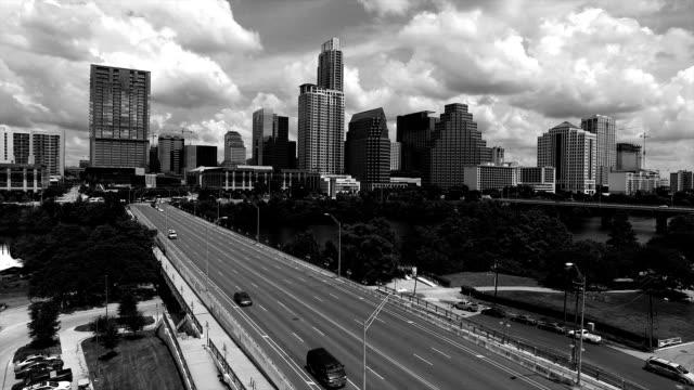 austin texas black and white aerial over 1st street bridge downtown atx iconic landmark view - viraggio monocromo video stock e b–roll