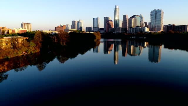 Austin Texas Cityscape Mirrored skyline over Town Lake Spring time golden hour