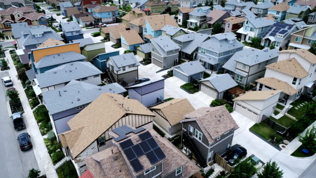 austin , texas developing a green future - solar panel rooftops - suburban stock videos & royalty-free footage
