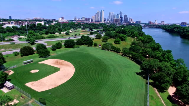 Austin Texas Over Basball Field with Downtown Skyline Background 4K