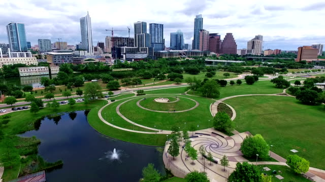 austin texas over modern gorgeous park space overlooking downtown - austin texas stock videos & royalty-free footage