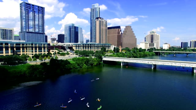 Austin Texas Over Town Lake Kayakers and Canoes and Stand Up Paddle Boards Summertime City Fun