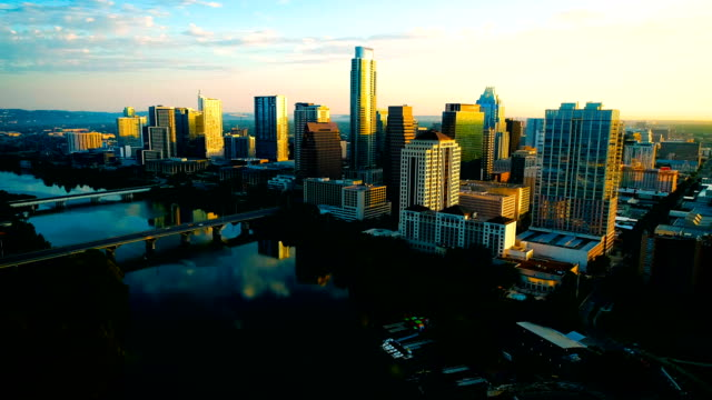 austin texas perfect sunrise golden hour morning reflection over lady bird lake - capital cities stock videos & royalty-free footage