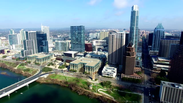 austin texas side pan high above town lake looking at downtown skyline to capital view and entire skyline - austin texas video stock e b–roll