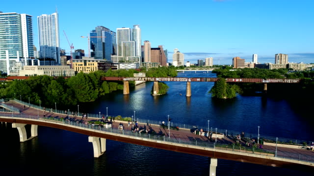 Austin Texas USA Blue Sky Summer Afternoon Crowd of People on Bridge Side pan middle