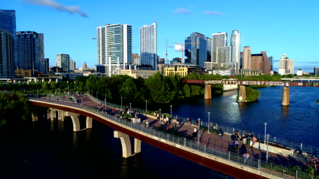 austin texas usa perfect sunset evening with large crowd of people of pedestrian bridge entire view - austin texas stock videos & royalty-free footage