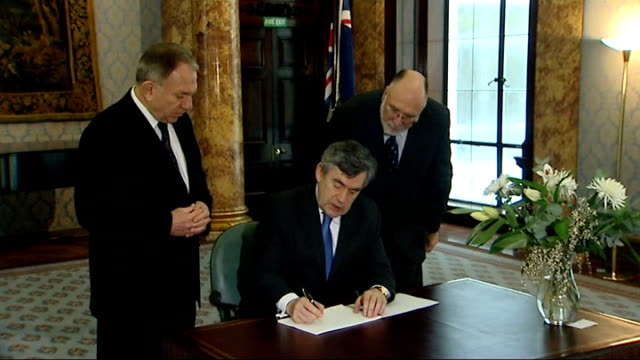 gordon brown signs book of condolence england london australia house int gordon brown mp into room and signs book of condolence to victims of recent... - in the loop 2009 film stock videos and b-roll footage