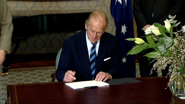 prince philip signs book of condolence; england: london: australia house: int prince philip into room and signing book of condolence at desk/ prince... - writing stock videos & royalty-free footage