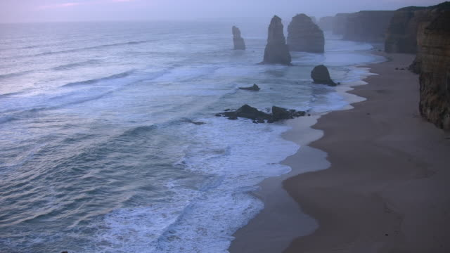 australia great ocean road 12 apostles after sunset zoomed out - port campbell national park stock videos & royalty-free footage