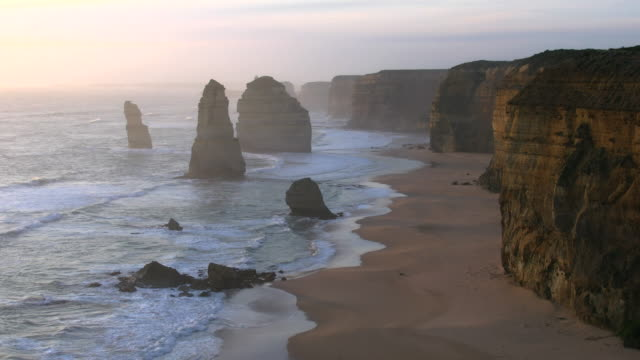 australia great ocean road 12 apostles grey with cliffs - great ocean road stock videos & royalty-free footage