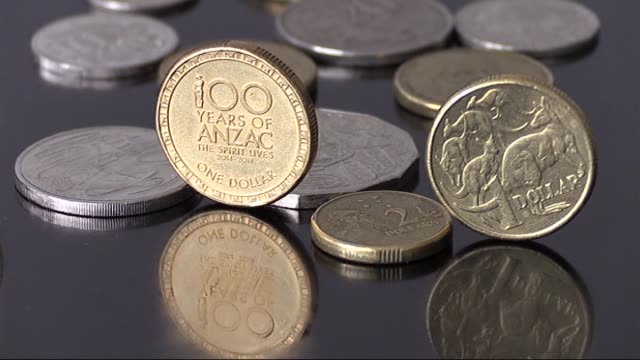 australia issued a coin reading '100 years of anzac, the spirit lives' to commemorate the anzac soldiers who lost their lives during world war one,... - anzac day stock videos & royalty-free footage