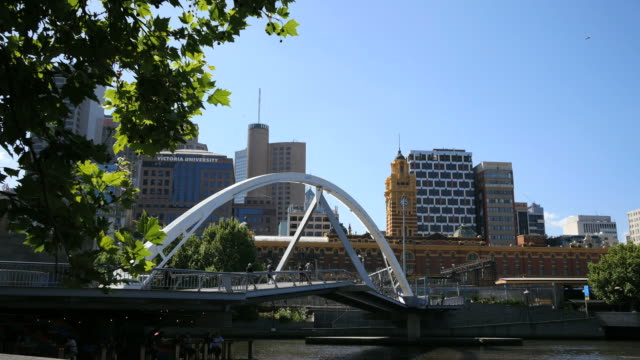 australia melbourne foot bridge with clock tower beyond - footbridge stock videos & royalty-free footage
