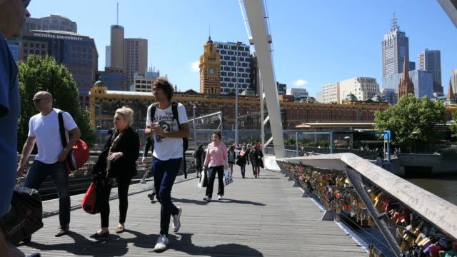 Australia Melbourne foot bridge Yarra River people walking across