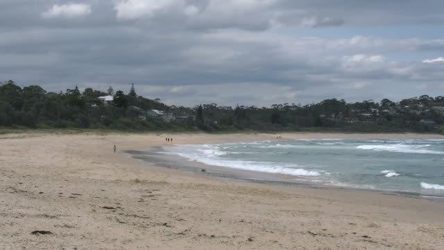 australia mollymook beach under cloudy sky pan - 2014年点の映像素材/bロール
