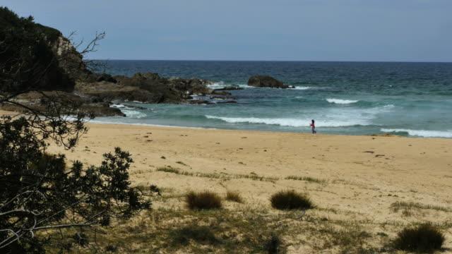 Australia Piccaninny Beach with girl Eurobodalla National Park