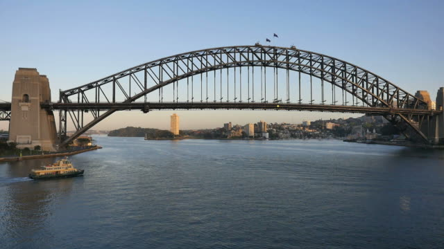 australia sydney boat moving under harbour bridge boat - ferry stock videos & royalty-free footage
