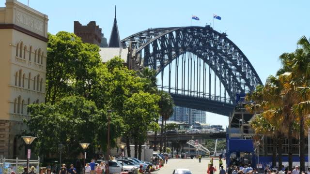 Australia Sydney busy street and harbour bridge