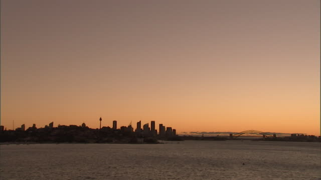 t/l, ws, australia, sydney, city skyline at dusk, harbor in foreground - dusk stock videos & royalty-free footage