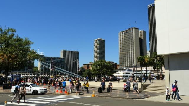 Australia Sydney people on sidewalk and crosswalk