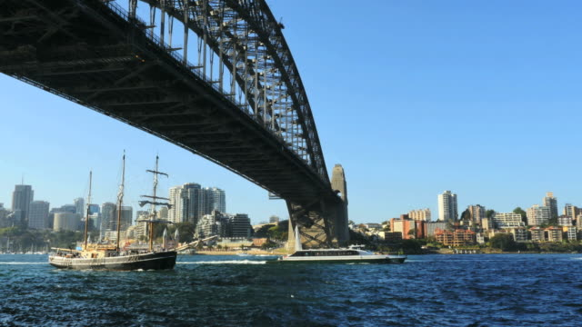 australia sydney several boats move under harbour bridge - establishing shot stock videos & royalty-free footage