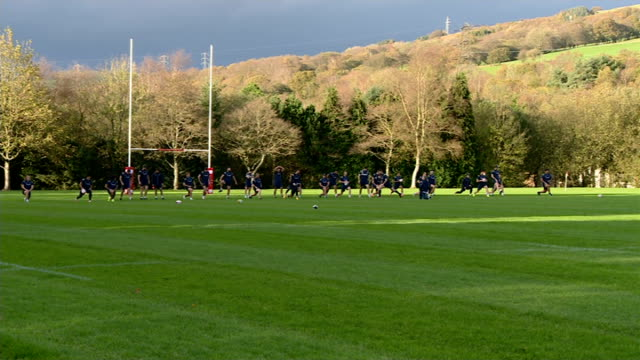 Australia training session WALES EXT Australia Rugby Union team training session on pitch players along throwing balls / players doing exercises and...