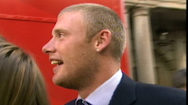 stockvideo's en b-roll-footage met australia will go into the ashes as underdogs t13090522 / ext andrew flintoff out of hotel and towards opentop bus he gives 'drinking' gesture to... - channel 4 news