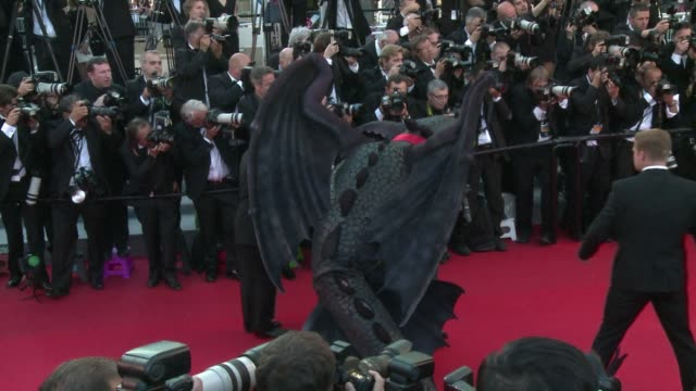 australian actress cate blanchett kisses a dragon as the cast of director dean debloiss how to train your dragon 2 walks the red carpet at the cannes... - how to train your dragon stock videos & royalty-free footage