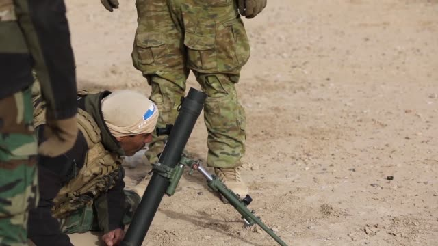 australian and us army trainers conduct mortar training with members of the qwat khasa iraqi army at a live fire range with 60mm mortars at the... - isis stock videos and b-roll footage