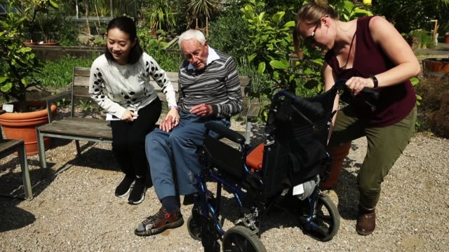 Australian botanist and academic David Goodall who is 104 years old chats with Taiwanese actress and television hostess Bowie Tsang during the...