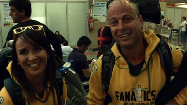 australian couple on supporting their national team. fans are seen exiting the international flight terminal at rio de janeiro galeao international... - national team stock videos & royalty-free footage