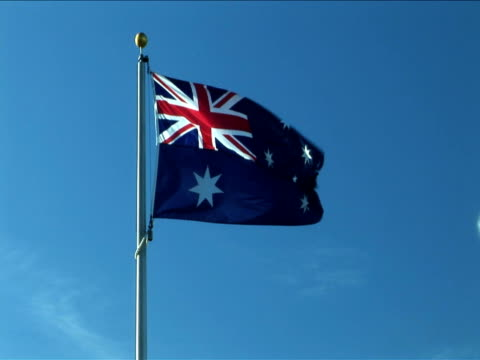 MS, Australian flag flapping against clear sky