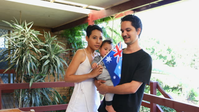 australian flag waving young happy aboriginal family - traditionally australian stock videos & royalty-free footage