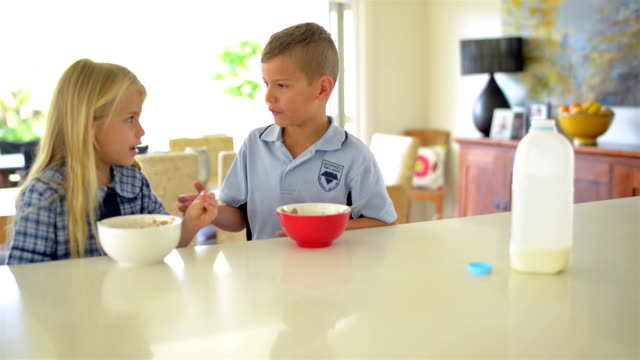 dolly shot: australian kids having breakfast before school - breakfast stock videos & royalty-free footage