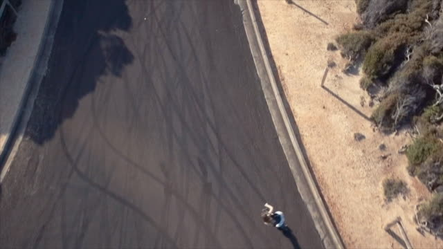 australian locals in sport: aerial view of a skater woman - empty road stock videos and b-roll footage